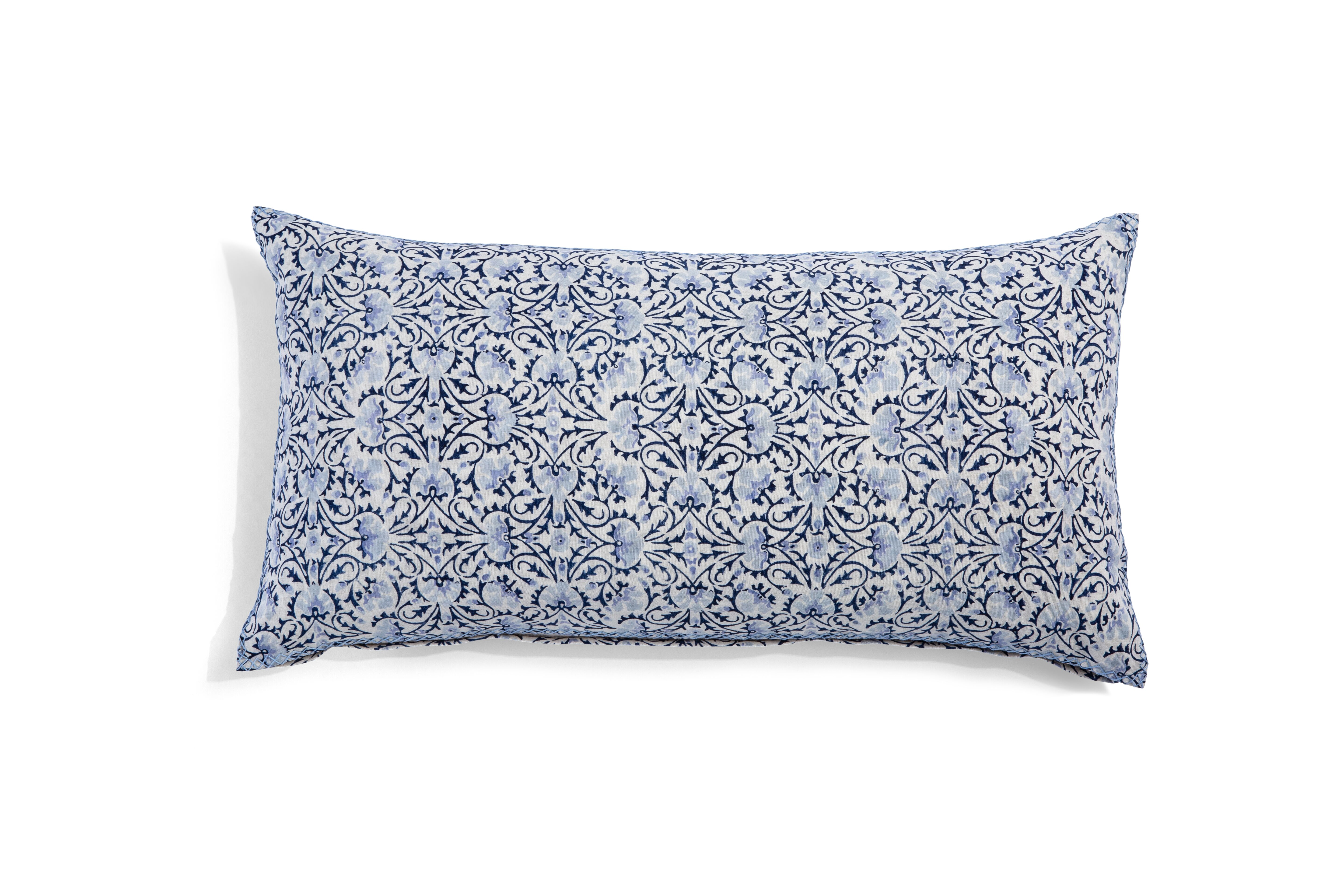 long pillow with blue swirl design