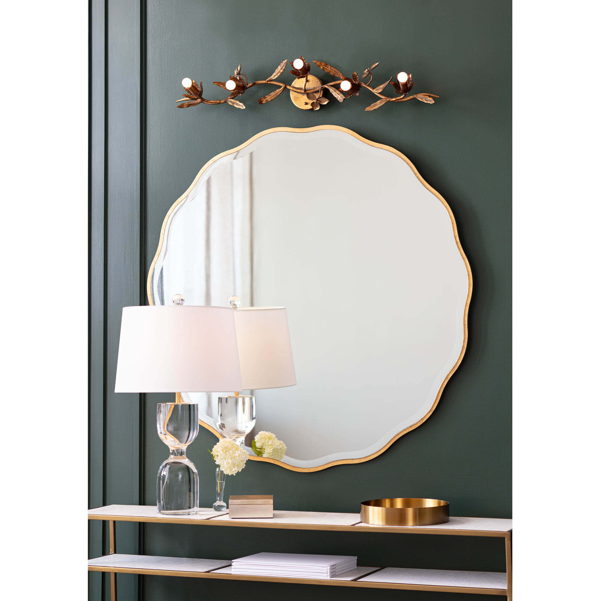 beveled edge mirror against emerald green wall