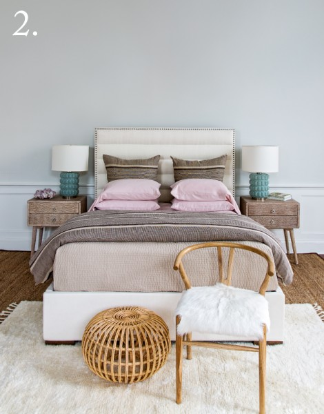 white channel headboard, wood endtables, aqua glass lamps pink and brown bedding, goat skin chair