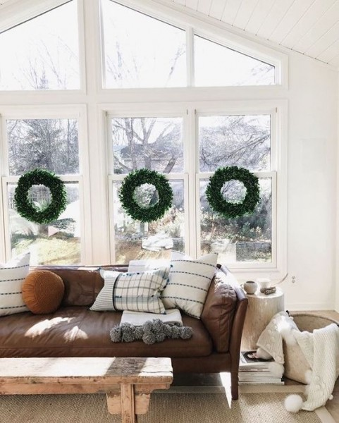 leather sofa boxwood wreaths on the windows