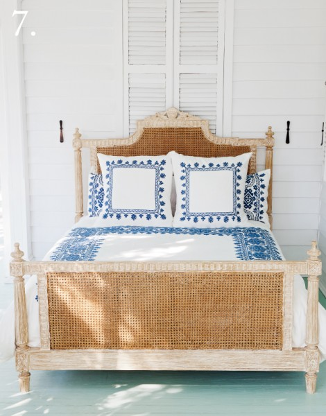 natural cane and white was bed with blue embroidered bedding