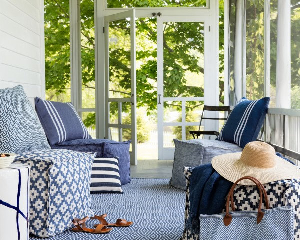 Add Pine Cone Hill's outdoor poufs for more seating