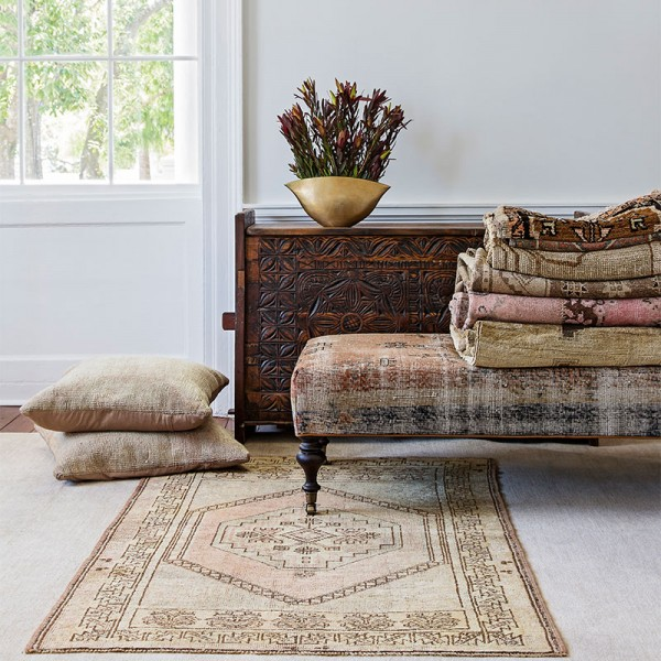 folded and stacked hand knotted rugs