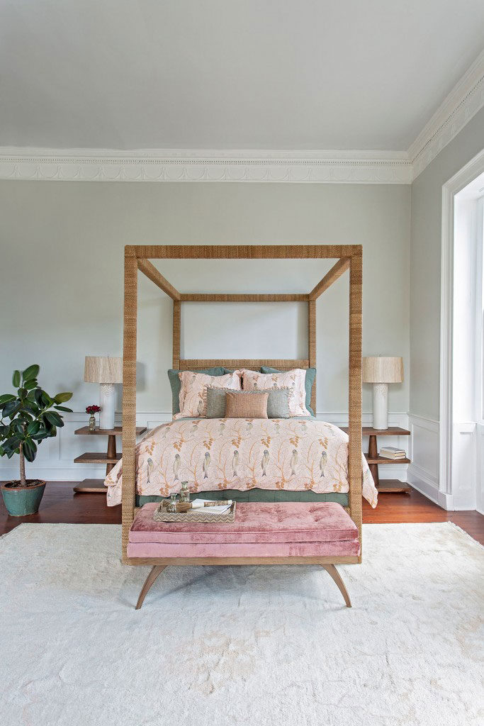 Neutral-toned rug beneath a wood poster bed