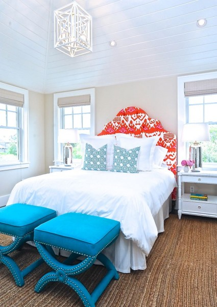 Bright tufted headboard with white bedding