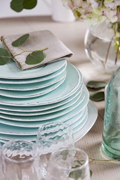 Aqua dinnerware  white glasses and linen napkin.