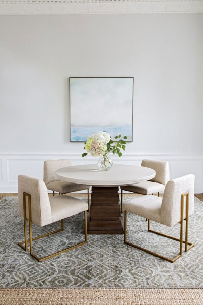 Dining room with round table and brass accented dining chairs