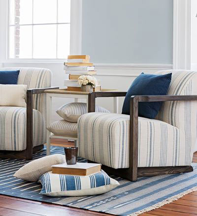blue and white striped, upholstered chairs with blue rug