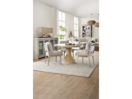 modern natural texture dining set used in charleston interior design inspiration
