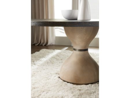hourglass shaped base of modern round dining table