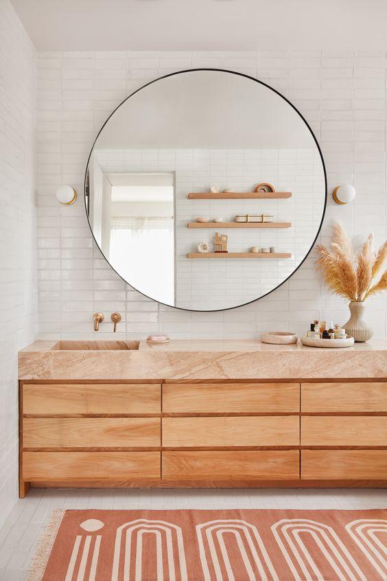 Statement circular mirror in minimalist bathroom design